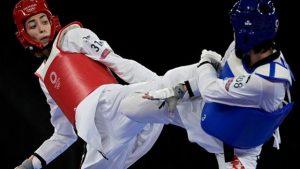 119564324 gettyimages 1234172011 594x594 1 300x169 - درخشش کیمیا علیزاده با شکست دادن قهرمان دو دوره المپیک